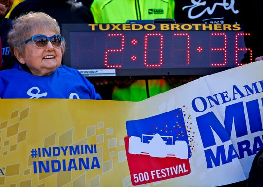 Holocaust survivor Eva Kor smiles and joins others at the end, Wednesday, Oct. 24, 2018, of the pace-setting run for the 2019 OneAmerica 500 Festival Mini-Marathon.  The 500 Festival will donate $1 to the CANDLES Holocaust Museum in Terre Haute for every mini-marathon participant who finishes the 2019 race in a better time than Team Eva, which was 2 hours, 7 minutes, 36 seconds.  Kor ran the very last part of the relay race to add to the time.
