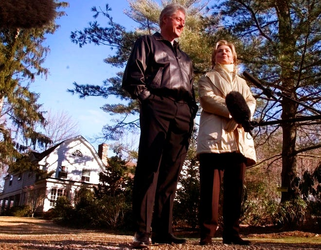 """In this Jan. 6, 2000 file photo, Bill and Hillary Clinton stand in the driveway of their new home in Chappaqua, N.Y. A U.S. official says a """"functional explosive device"""" was found at Hillary and Bill Clinton's suburban New York home."""