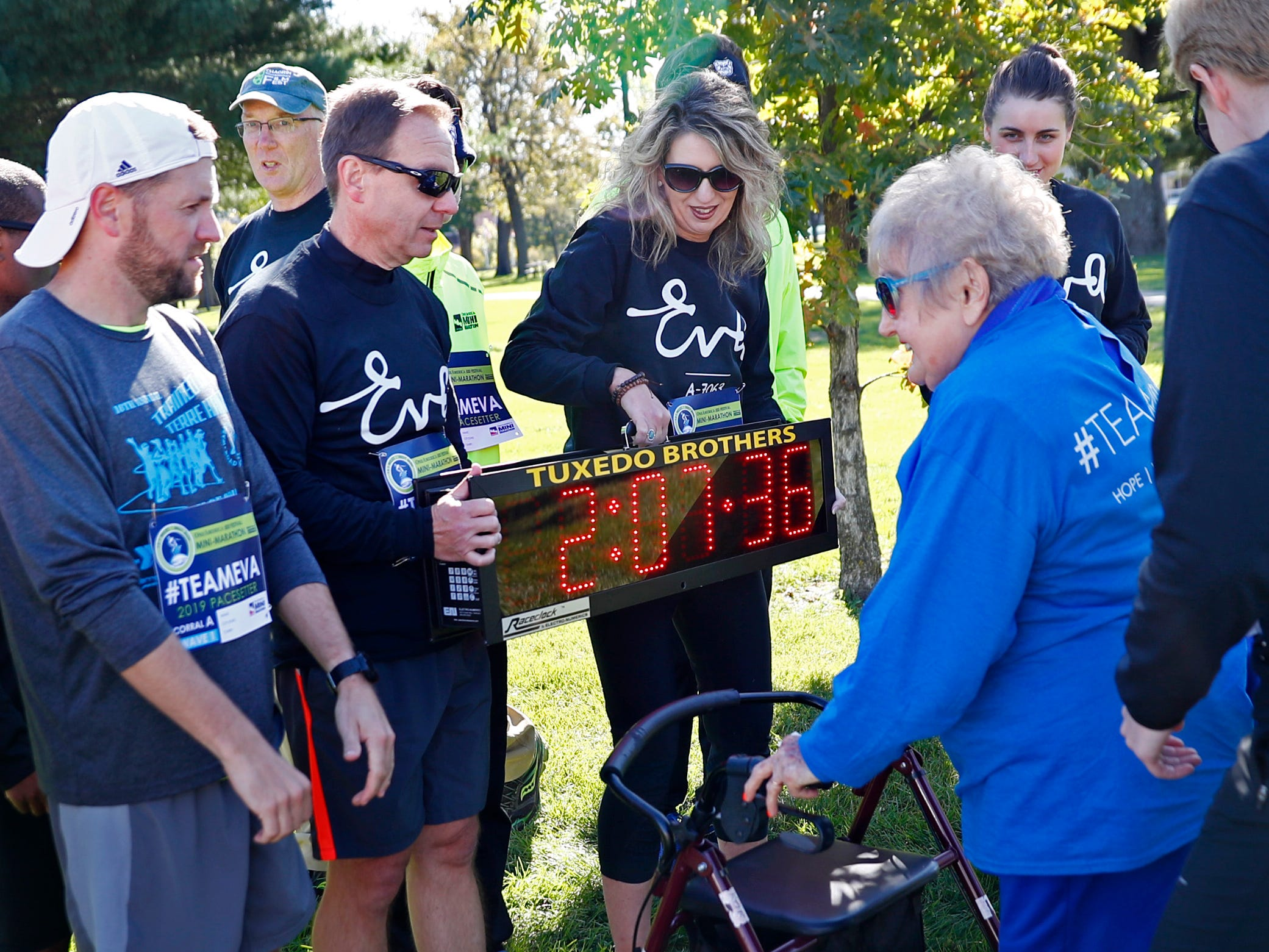 Holocaust survivor Eva Kor joins others after the relay running of the pace-setting run for the 2019 OneAmerica 500 Festival Mini-Marathon, Wednesday, Oct. 24, 2018.  The 500 Festival will donate $1 to the CANDLES Holocaust Museum in Terre Haute for every mini-marathon participant who finishes the 2019 race in a better time than Team Eva, which was 2 hours, 7 minutes, 36 seconds.  Kor ran the very last part of the relay race to add to the time.