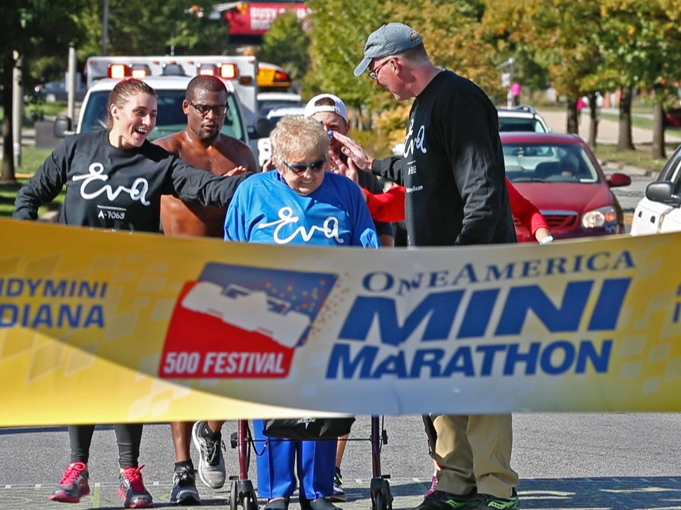 Holocaust survivor Eva Kor gets ready to run the end leg of the pace-setting run for the 2019 OneAmerica 500 Festival Mini-Marathon, Wednesday, Oct. 24, 2018.  The 500 Festival will donate $1 to the CANDLES Holocaust Museum in Terre Haute for every mini-marathon participant who finishes the 2019 race in a better time than Team Eva, which was 2 hours, 7 minutes, 36 seconds.
