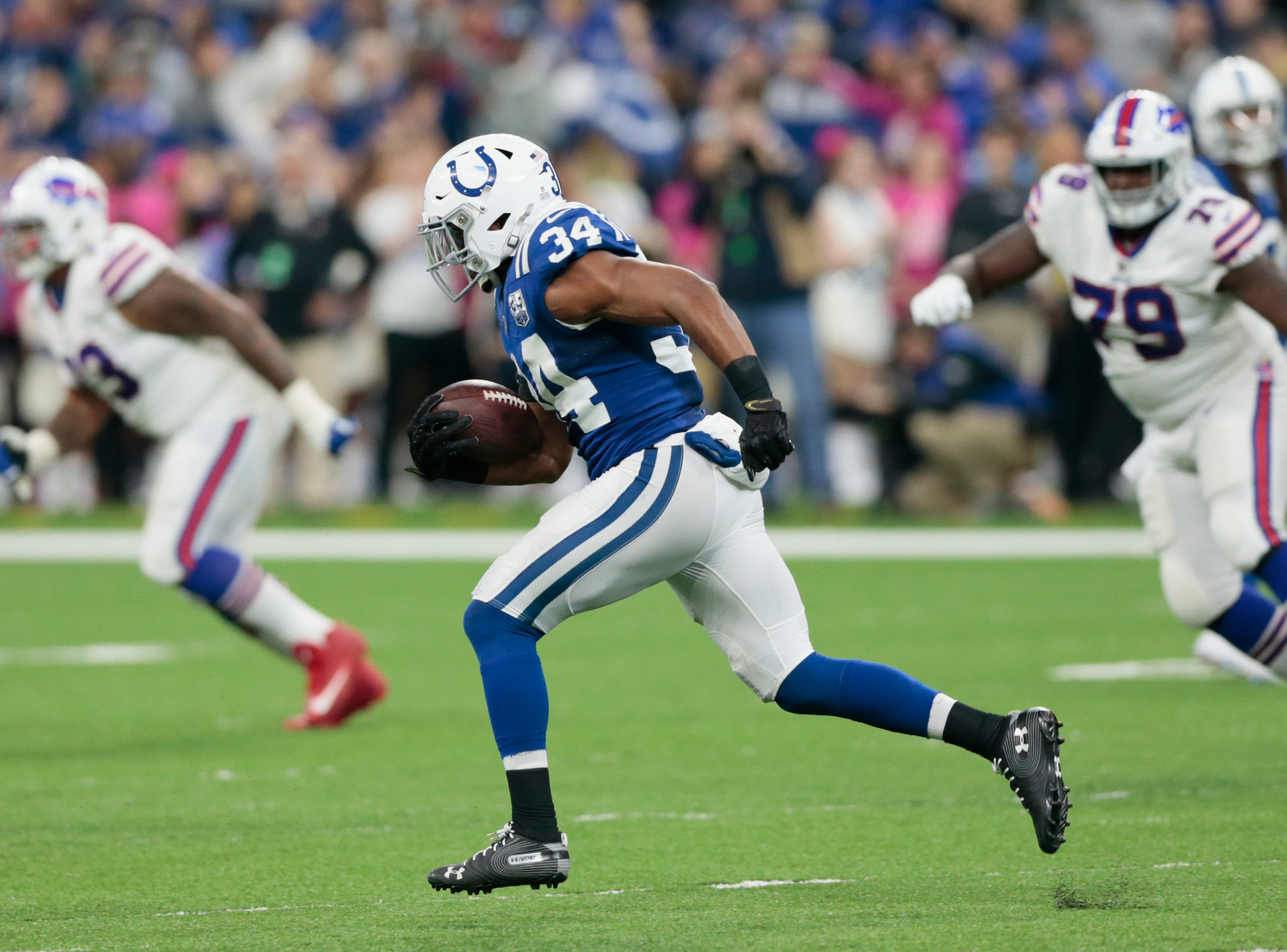 Indianapolis Colts defensive back Mike Mitchell (34) returns an interception against the Buffalo Bills during the first half of an NFL football game in Indianapolis, Sunday, Oct. 21, 2018. (AP Photo/AJ Mast)