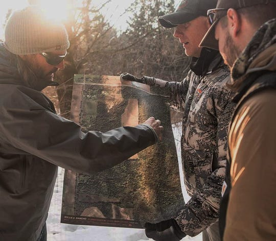 Hunterra maps, as shown in this company website photo, are often used by hunters in the field to plan hunts and better familiarize themselves with their hunting terrain.