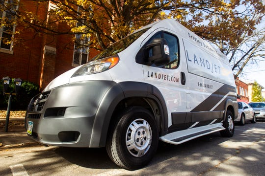 """A """"rolling board room"""" Landjet vehicle is seen on Wednesday, Oct. 24, 2018, while parked in Iowa City."""