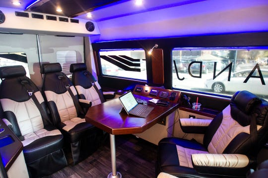 "The interior of a 4-6 passenger ""rolling board room"" Landjet vehicle is seen on Wednesday, Oct. 24, 2018, while parked in Iowa City."