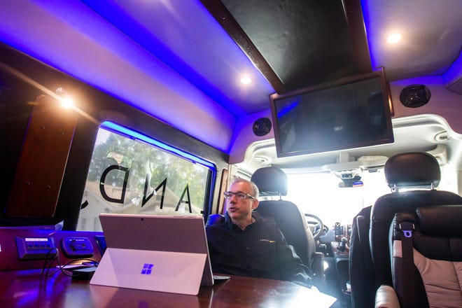 "Mark Ross, Landjet CEO, speaks during an interview inside of a 4-6 passenger ""rolling board room"" Landjet vehicle on Wednesday, Oct. 24, 2018, while parked in Iowa City."