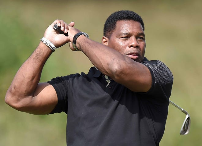 Herschel Walker watches his tee shot on the 10th hole in the Allen Exploration Pro-AM on Wednesday, October 24, 2018, at the Sanderson Farms Championship at the Country Club of Jackson in Jackson, Miss.