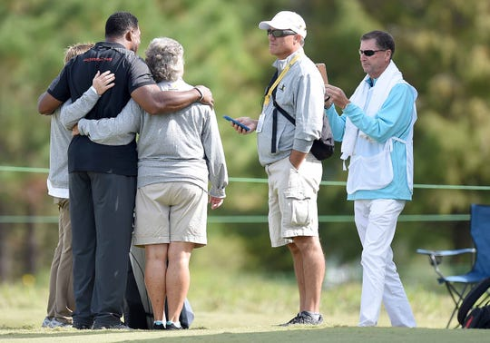 Herschel Walker poses for pictures on the 10th hole on Wednesday, October 24, 2018, at the Sanderson Farms Championship at the Country Club of Jackson in Jackson, Miss.
