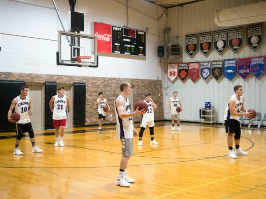 The Crown College basketball team during practice on Tuesday, October 23, 2018. Eight of the 11 players on the current roster are freshmen. Ten of the players have part-time jobs.