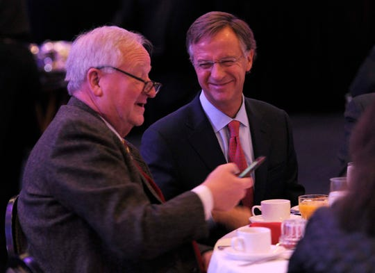 Knoxville Chamber President and CEO Mike Edwards, left, talks with Gov. Bill Haslam in 2016.