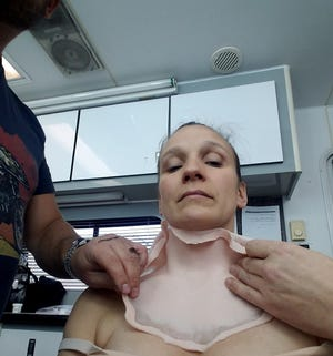 """Marian Sing of Knoxville gets prosthetics applied to her body for her role in 2018's """"Halloween."""""""