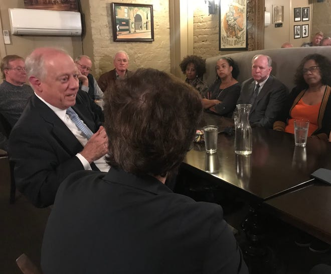 Senate candidate Phil Bredesen, left, speaks with about 20 people during a roundtable Wednesday at Bistro at the Bijou in downtown Knoxville.