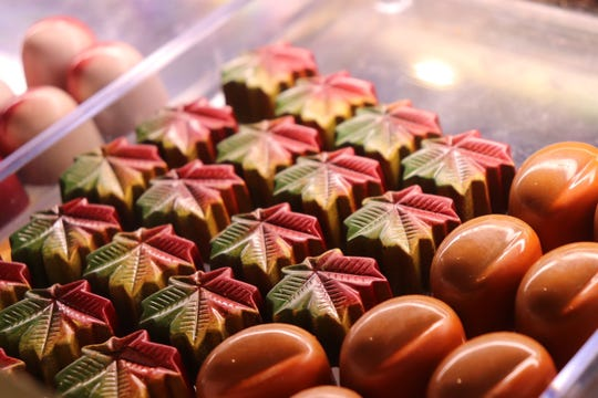 Coffee and Chocolate, in Market Square, creates professional chocolate truffles in a variety of designs. As Halloween approaches, it is producing more fall-themed treats.