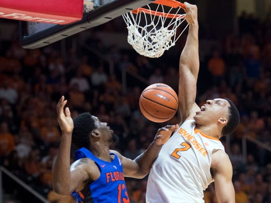 Tennessee's Grant Williams scores over Florida's Kevarrius Hayes on Wednesday, February 21, 2018. Tennessee defeated Florida, 62-57.