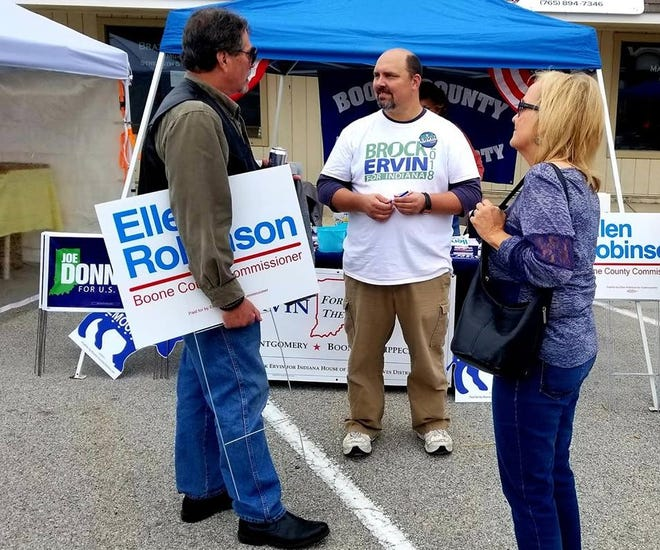 Brock Ervin, center, campaigns during an event in Boone County. Ervin, a Crawfordsville Democrat, is challenging state Rep. Tim Brown, a Crawfordsville Republican and chairman of the House Ways and Means Committee, for the seat in the Nov. 6 election.