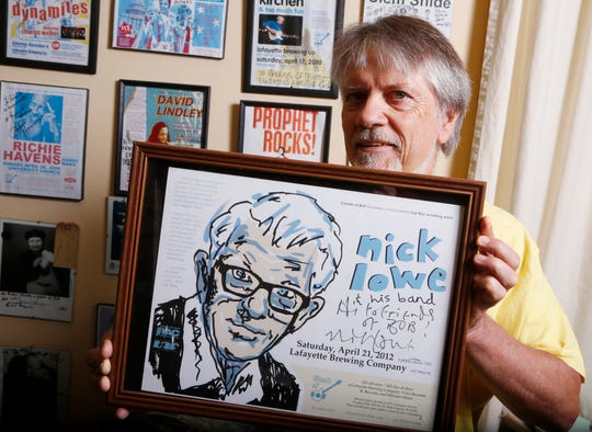 Richard Fudge with an autographed poster from Nick Lowe, who performed a Friends of Bob show in 2012, Wednesday, October 24, 2018, in his Battle Ground home. The popular Friends of Bob performances will come to an end after 25 years and 187 memorable shows.