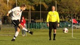 Watch Grand Blanc beat Brighton on goal with 2:35 left.