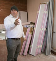 Hartland Brewing Company co-owner Ryan McDonald explains the layout of the soon-to-open microbrewery Wednesday, Oct. 24, 2018, standing in the back room where beer coolers will be installed.