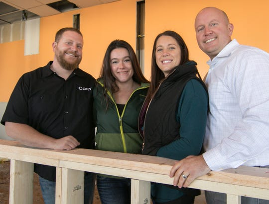 Hartland Brewing Company is expected to open in December. Shown Wednesday, Oct. 24, 2018 are, from left, head brewer Cory Fernelius and his wife Barbie and owners Nikki and Ryan McDonald.