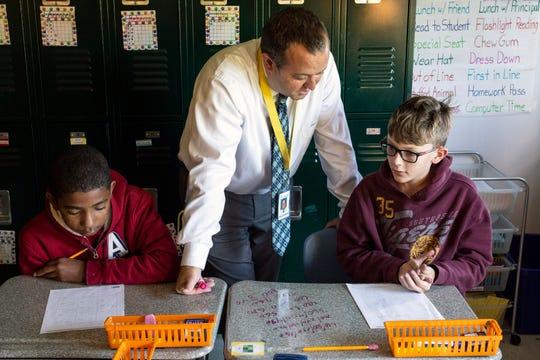 Alex R. Kennedy Elementary School principal Patrick Sivori helps student Benjamin Johnson work through a math problem. 10/19/18