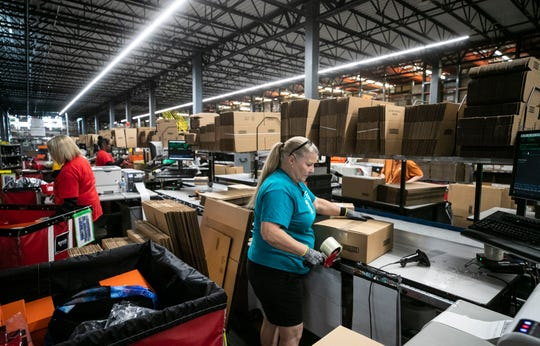Radial employees are kept busy sorting and packing clothes, shoes and other consumer goods at one of the two large fulfillment centers off Trade Port Drive in Louisville's South End recently. Radial is looking to hire 6,500 people to help during the holiday season. Oct. 24, 2018