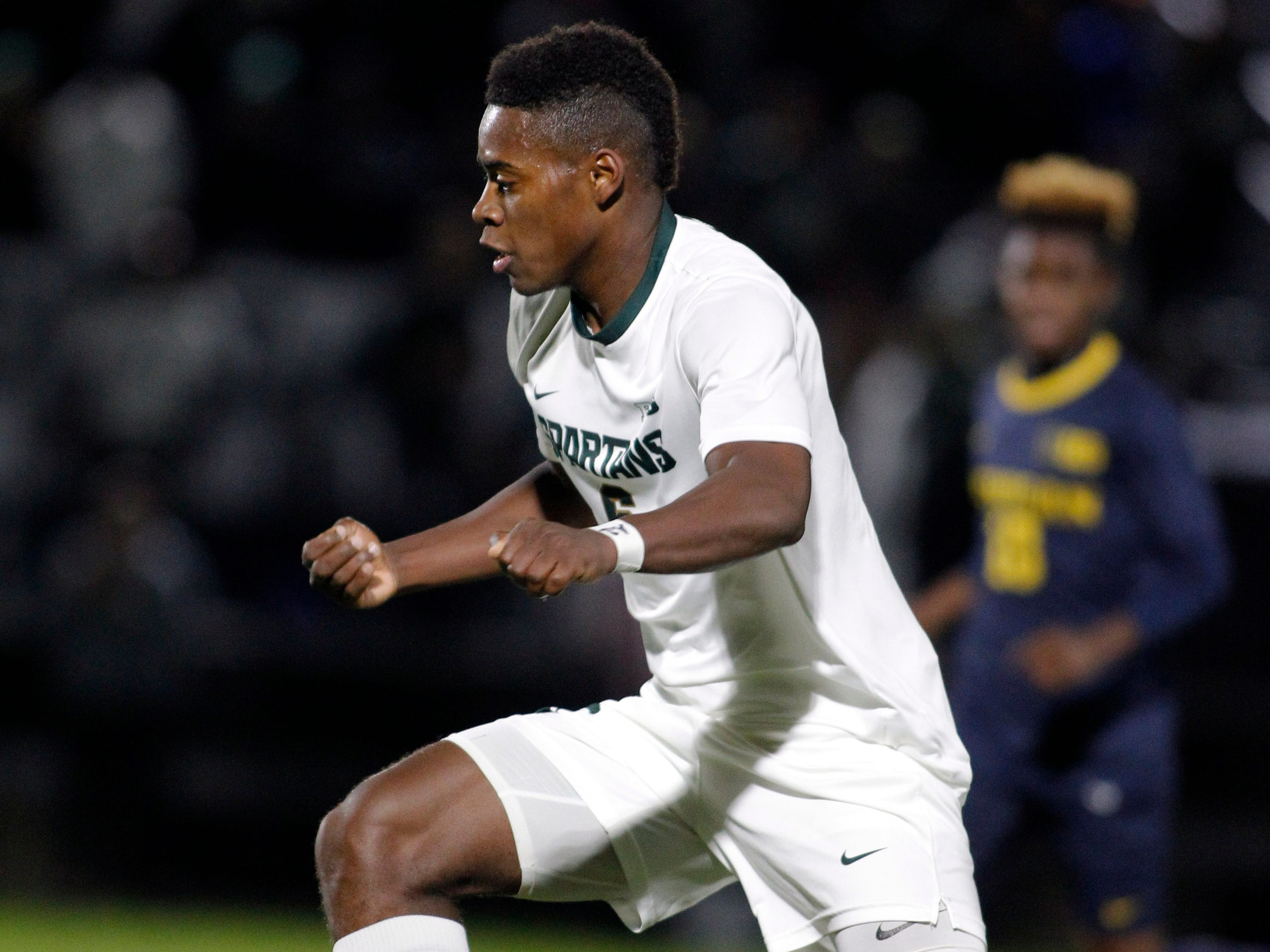 Michigan State's DeJuan Jones attacks against Michigan, Tuesday, Oct. 23, 2018, in East Lansing, Mich. The teams played to a 1-1 draw.