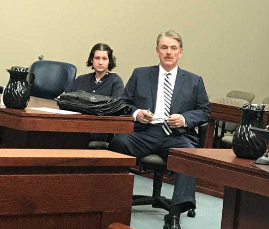 Brandon Addiss (far left) listens next to his attorney Michael Hocking as Tammy Hawkins (not pictured) gives a victim impact statement at Addiss's sentencing hearing for the stabbing death of John Darnell Jr.
