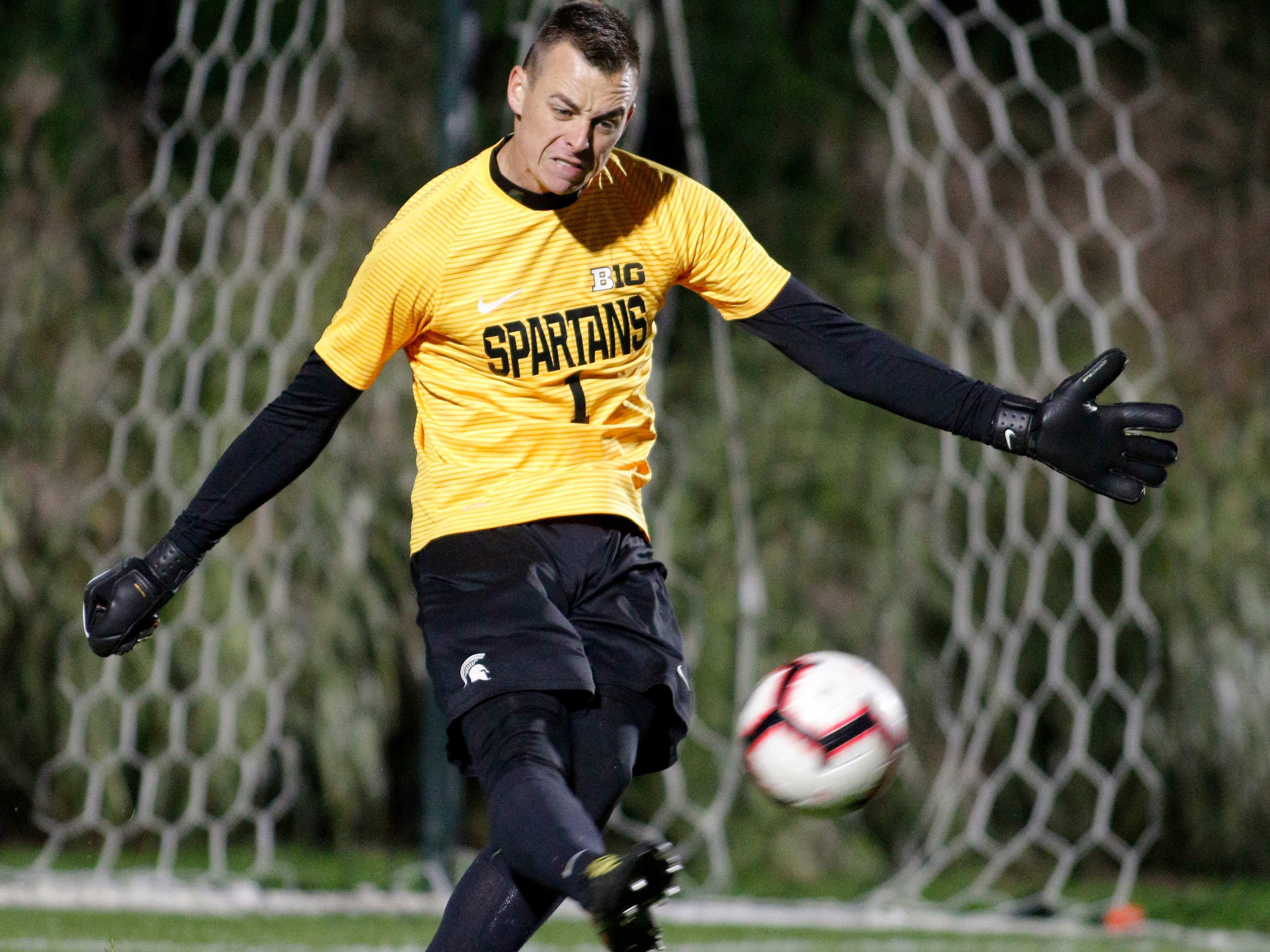 Michigan State goalkeeper Jimmy Hague clears the ball against Michigan, Tuesday, Oct. 23, 2018, in East Lansing, Mich. The teams played to a 1-1 draw.