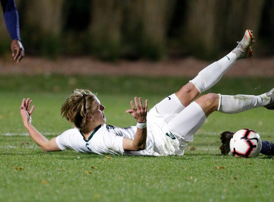 Michigan State's Jack Beck hits the ground against Michigan, Tuesday, Oct. 23, 2018, in East Lansing, Mich. The teams played to a 1-1 draw.