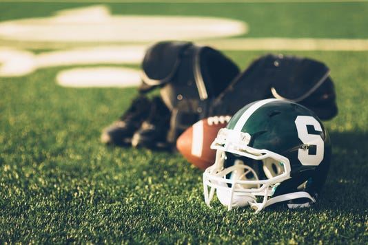 Green Football Helmet On Field