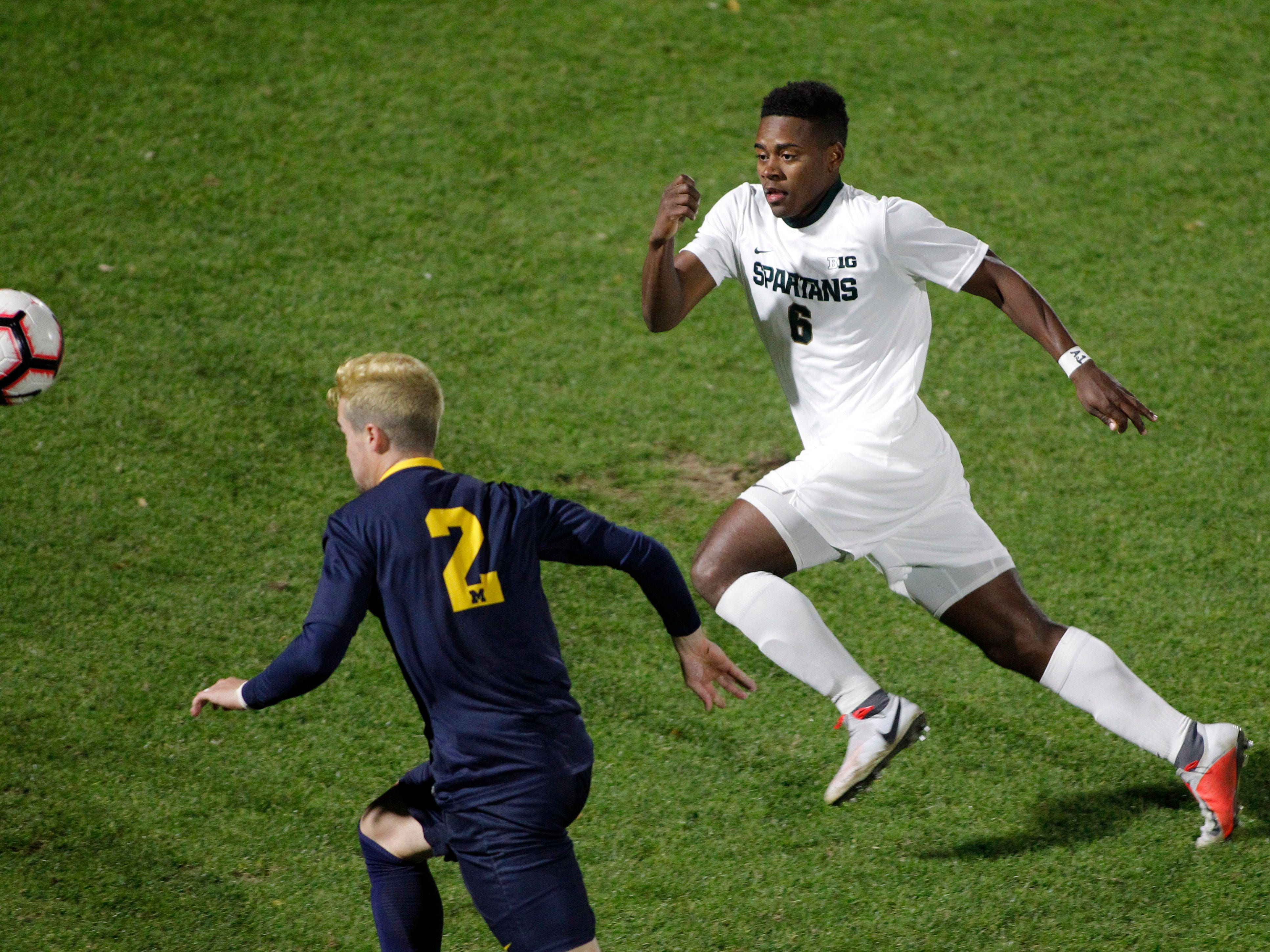 Michigan State's DeJuan Jones, right, and Michigan's Marcello Borges (2) chase the ball, Tuesday, Oct. 23, 2018, in East Lansing, Mich. The teams played to a 1-1 draw.