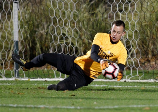 Michigan State goalkeeper Jimmy Hague makes a stop against Michigan, Tuesday, Oct. 23, 2018, in East Lansing, Mich. The teams played to a 1-1 draw.