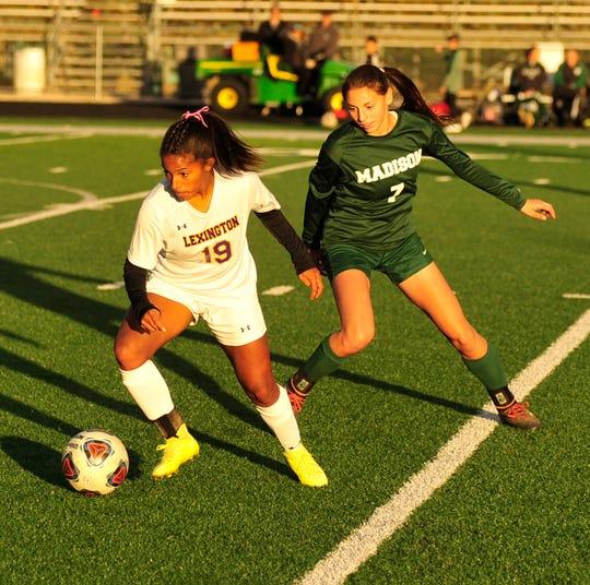 Lexington's Lacee Bethea kicks the ball away from Madison's Kari Eckenwiler on Tuesday.