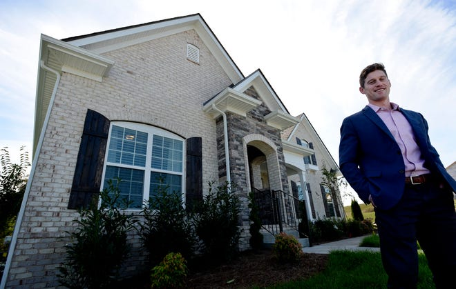 Regent Homes affiliate broker Coby Comer stands in front of a model home at Waltons Grove, Tuesday, Oct. 23, 2018, in Mt. Juliet. Home buyers are coming to Wilson County for the affordability, schools, quality of life and location just outside a major metropolitan city.