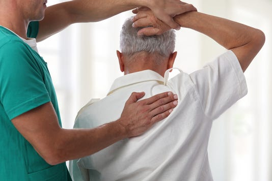 Senior Man Having Chiropractic Back Adjustment Osteopathy Physiotherapy Pain Relief Concept