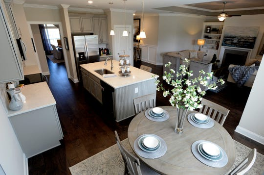 The kitchen and living area inside a model home at Waltons Grove in Mt. Juliet.
