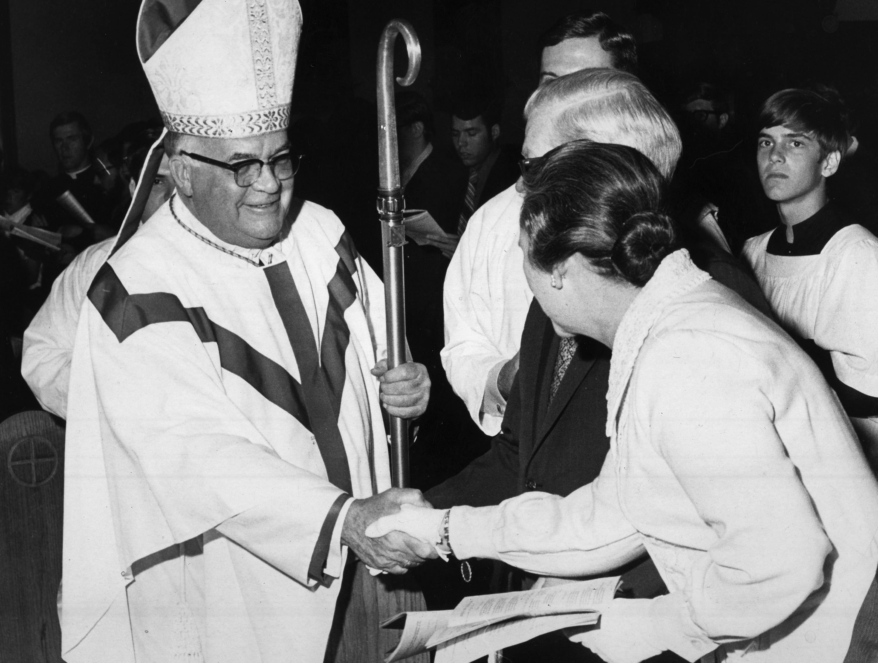052111 BYGONE             Bishop Carroll T. Dozier, of the Catholic Diocese of Memphis, shakes hands with Dr. and Mrs. David Taylor during a processional on May 21, 1971.  (Richard Gardner / The Commercial Appeal files)