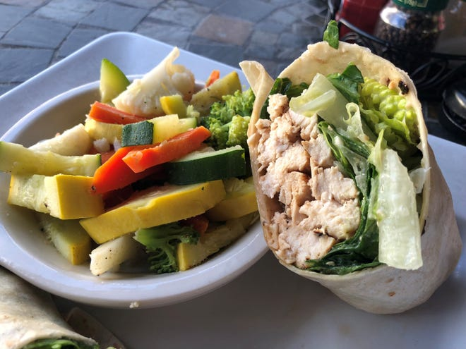 The chicken Caesar wrap and mixed veggies from Sunset Grille, Marco Island.