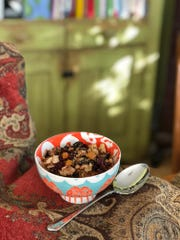 This quinoa granola is laced with dried fruits and sweetened with maple syrup.