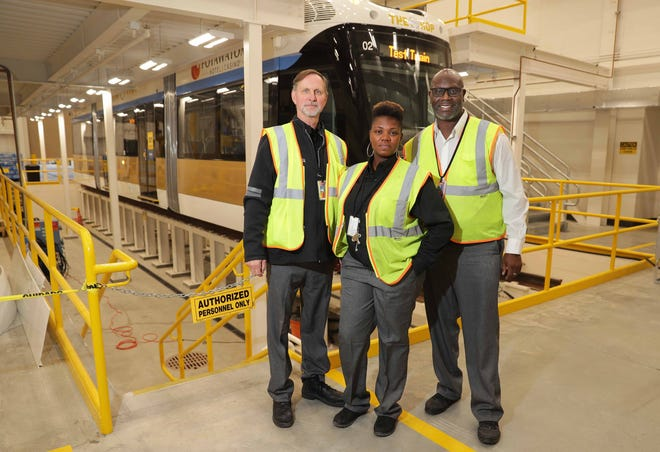 Milwaukee streetcar operators (from left) Bob Franson and Nicole Martin, along with supervisor Darricke Bennett stand in front of a streetcar in the operations and maintenance building, located under I-794 on Vel R. Phillips Avenue in Milwaukee on Wednesday, October 24, 2018. Employee training has been taking place in preparation for the grand opening of the Milwaukee streetcar — known as The Hop — on November 2. -  Photo by Mike De Sisti / Milwaukee Journal Sentinel