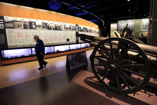 A docent walks past a French artillery piece at the National World War I Museum and Memorial in Kansas City on Feb. 16, 2017.
