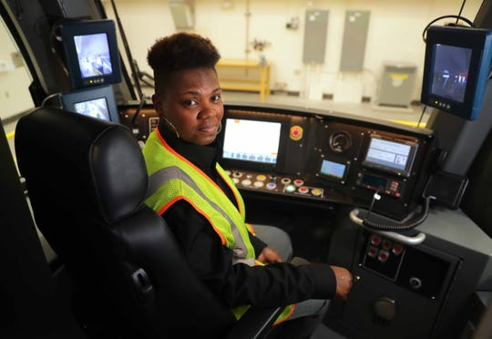 Milwaukee streetcar operator Nicole Martin sits inside a streetcar in the operations and maintenance building, located under I-794 on Vel R. Phillips Avenue in Milwaukee on Wednesday, October 24, 2018. Employee training has been taking place in preparation for the grand opening of the Milwaukee streetcar — known as The Hop — on November 2.  -  Photo by Mike De Sisti / Milwaukee Journal Sentinel