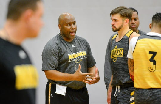 Milwaukee men's basketball coach Pat Baldwin talks during practice with guard Jake Wright, a graduate transfer expected to provide leadership and scoring to the Panthers.