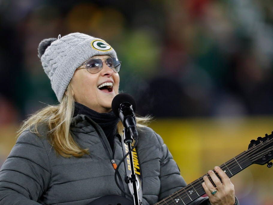 Melissa Etheridge performs during the halftime of an NFL football game between the Green Bay Packers and San Francisco 49ers, Monday, Oct. 15, 2018, in Green Bay, Wis. (AP Photo/Matt Ludtke) ORG XMIT: WIKS1