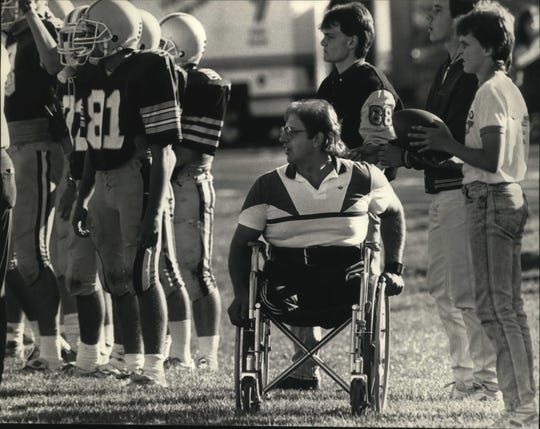 Bob Wieland watches a Greenfield/Greendale football game in 1987. Wieland was quarterback for Greenfield in 1964.