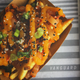 The Vanguard, 2659 S. Kinnickinnic Ave., tops fries with kimchi, black and white sesame seeds, green onion and mango-chile sauce for a tangy-sweet-spicy effect. It also serves kimchi on a hot dog.