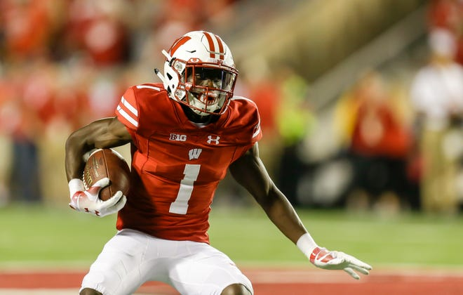 Wisconsin wide receiver Aron Cruickshank (1) against Western Kentucky during the second half of an NCAA college football game Friday, Aug. 31, 2018, in Madison, Wis. Wisconsin won 34-3. (AP Photo/Andy Manis) ORG XMIT: WIAM1