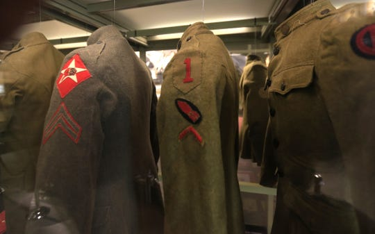 Uniforms hang on display at the National World War I Museum and Memorial in Kansas City, Mo.
