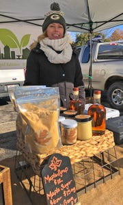 Deb Diaz from Big City Greens sells assorted Wisconsin maple products at the Shorewood Farmers Market.