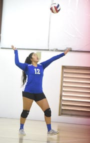 Cotter's Samantha Sanchez serves during the Lady Warriors' victory Tuesday.