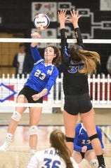 Mountain Home's Claudia Carter hits against Lakeside on Tuesday night.